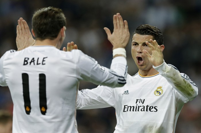 Gareth Bale and Cristian Ronaldo-Photo by Paul White/AP
