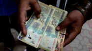India's Currency Swap Sees Economy Take A Hit