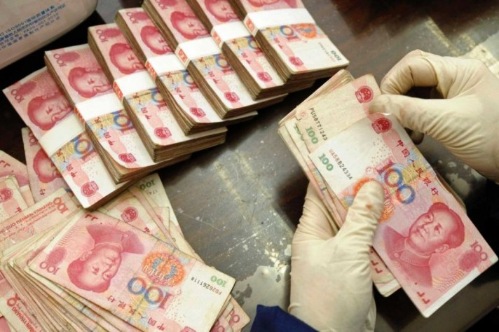 China's Foreign Reserves Drop Below USD3 trillion to Six-Year Low
