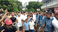 Anies Casts His Vote, Meets Supporters