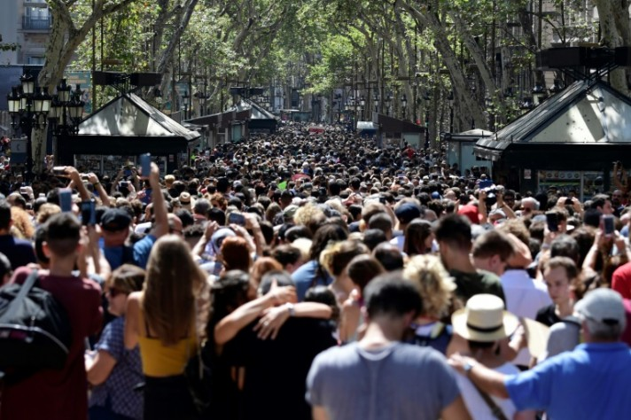 14 Dead in Twin Attacks as Spanish Police Launch Manhunt