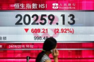 Asian Investors Move Cautiously as Fed Decision Approaches
