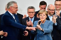 Merkel Wins Fourth Term, Hard Right Gains Foothold in Parliament