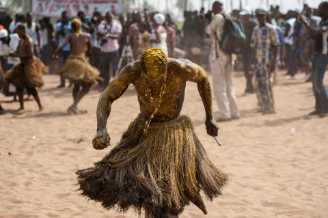 A Voodoo devotee in a trance performs at the annual Voodoo Festival on January 10, 2017 in Ouidah. (Photo:AFP/Stefan Heunis)