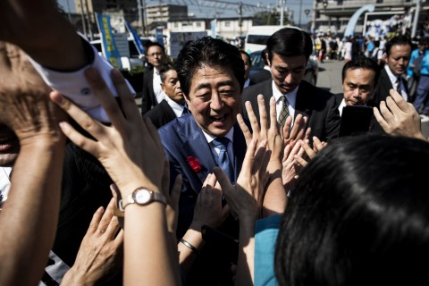 Japan's Prime Minister and ruling Liberal Democratic Party (LDP) president Shinzo Abe greets supporters during an election campaign in Yaizu, Shizuoka prefecture, on October 11, 2017. (Photo:AFP/Behrouz Mehri)