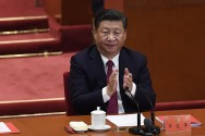 Xi Joins Mao in Communist Constitution, Tightening Grip on China