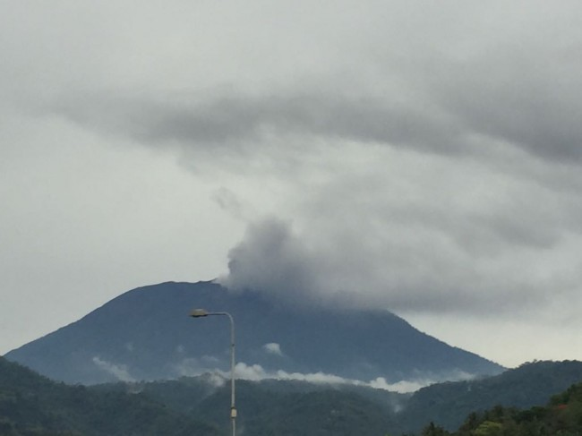 Mount Agung Spews Black Smoke