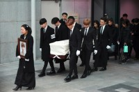 K-Pop Stars Carry Singer's Coffin after Suicide