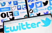 Twitter Reports First-Ever Profit, Boosting Shares