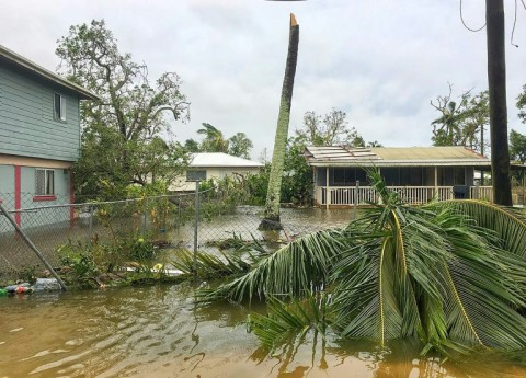 Severe Cyclone Gita unleashed 230 kmh (142 mph) winds on Tonga's most populous island, tearing roofs off buildings, downing powerlines and causing extensive flooding. (Photo:AFP/Virginie Dourlet)
