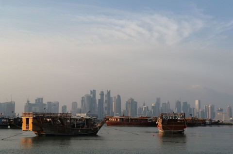 A general view taken on September 24, 2017 shows boats morred in front of the skyline of the Qatari capital, Doha, on September 24, 2017.  (Photo:AFP/Karim Jaafar)
