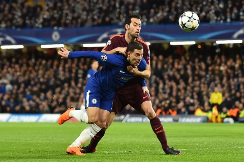 Sergio Busquets  (AFP PHOTO / Glyn KIRK)