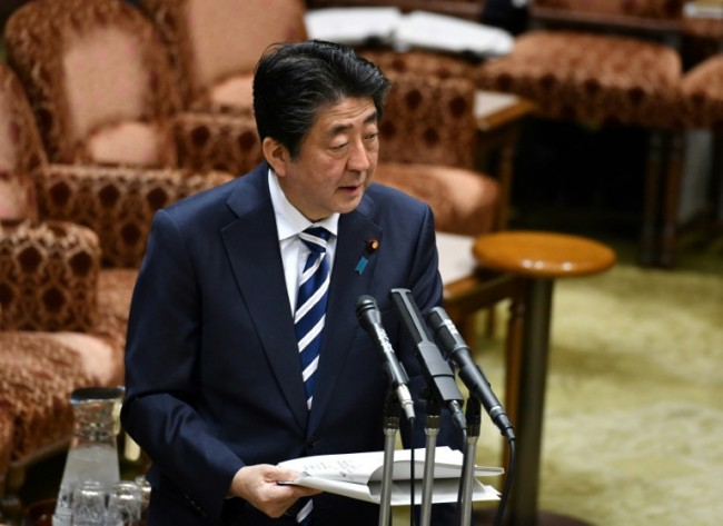 Defiant Abe Hits Back over Scandal as Support Plunges