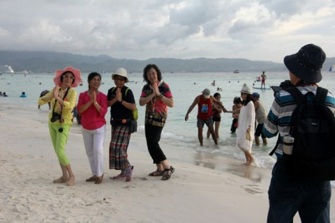 A bustling tourist trade on Boracay island serves some two million guests a year and pumps roughly $1 billion in revenues into the Philippine economy. (Photo:AFP)