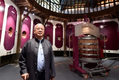 Kwok has earned respect from locals thanks to the quality of his wines . (Photo:AFP/Georges Gobet)