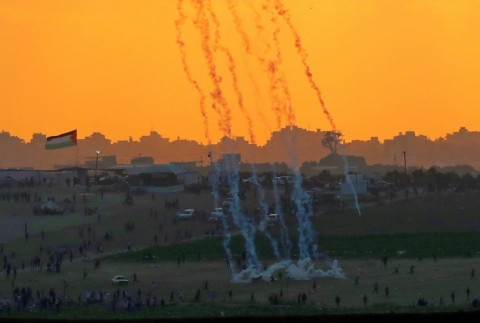 Tear gas rises amidst Palestinian protesters during clashes along the Gaza border in this picture taken from the Israeli side of the frontier on May 15, 2018. (Photo:AFP/Jack Guez)