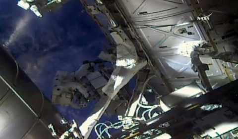 Veteran spacewalkers Ricky Arnold and Drew Feustel are checking on two external cooling boxes outside the International Space Station. (Photo:AFP/NASA TV_