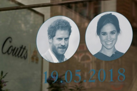 Pictures of Britain's Prince Harry and his fiancee, US actress Meghan Markle are displayed in a shop window in central London. (Photo:AFP/Daniel Leal-Olivas)