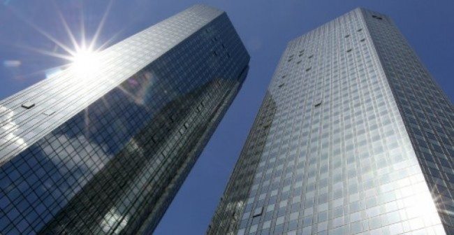 S&P Cuts Troubled Deutsche's Rating by a Notch to BBB+