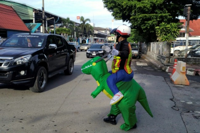Doyouthinkhesaurus: Thai 'T-Rex' Cop Gives Traffic Safety Lessons