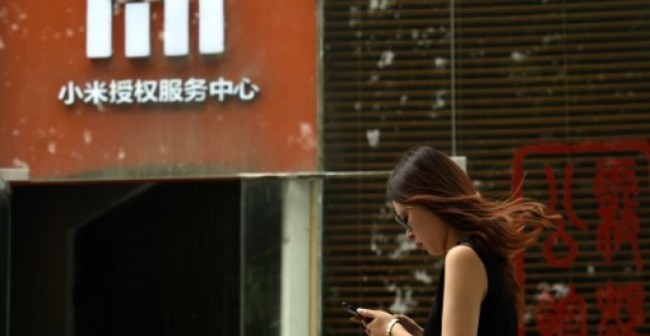 Xiaomi Lowers Target as It Kicks Off IPO