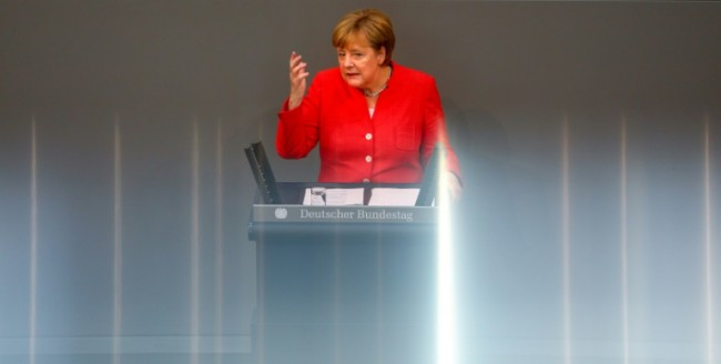 Merkel Warns Trump against Trade War over Car Tariffs Threat