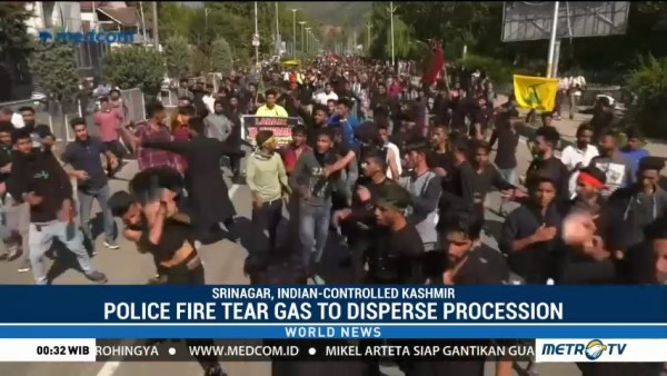 Police Fire Tear Gas to Disperse Procession