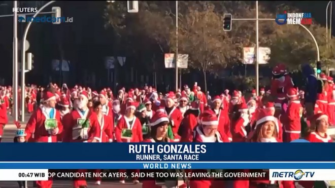 Thousands Dressed as Santa Race to Raise Money for Cancer Care